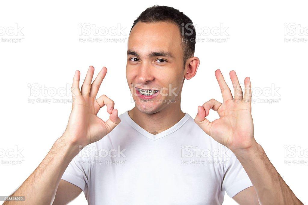 Brunette man with brackets stock photo