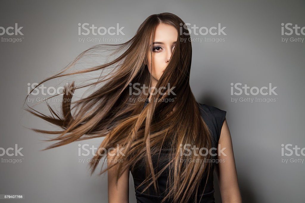 Brunette model with windy hair stock photo