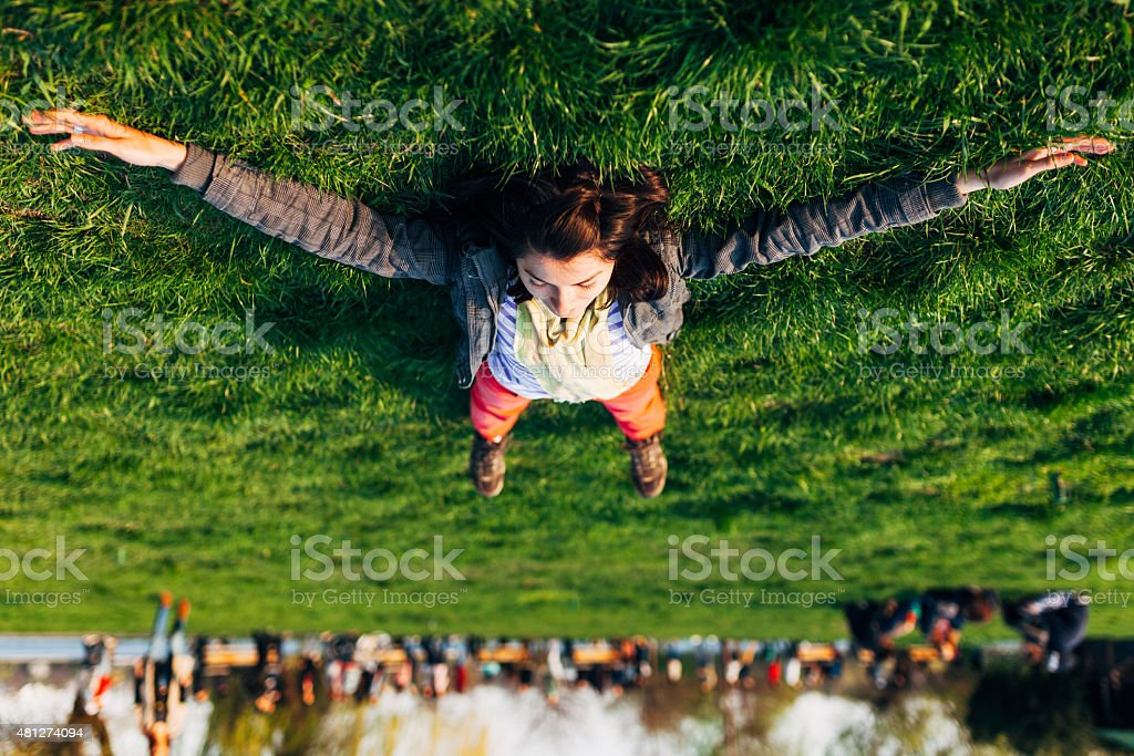Brunette on the grass stock photo