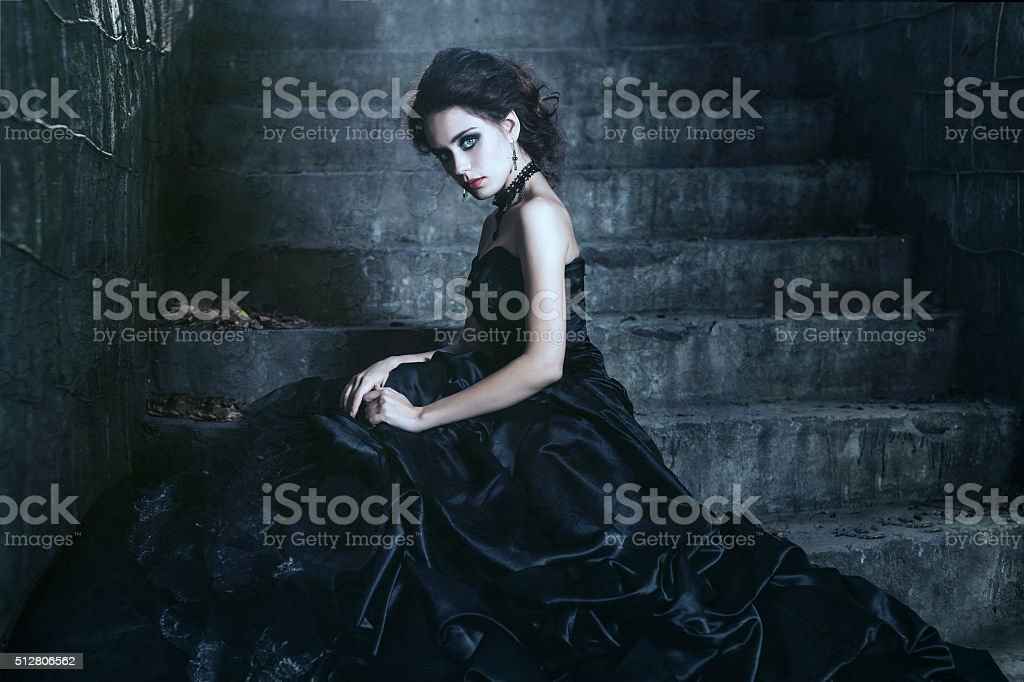 Brunette over the building background stock photo