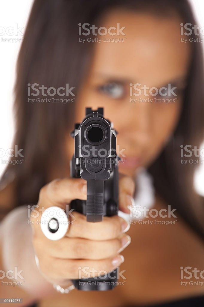 Brunette pointing a gun royalty-free stock photo