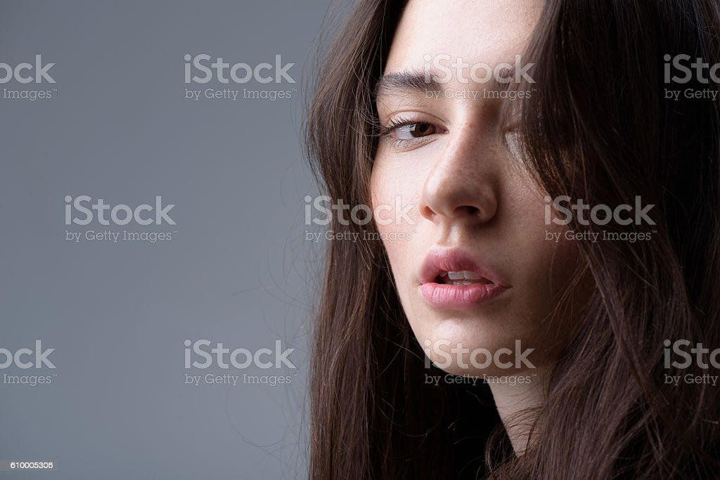 brunette portrait isolated on light grey background stock photo