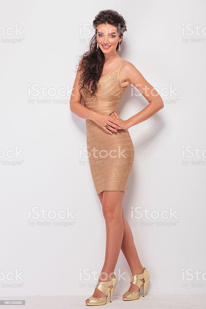 brunette posing full body while touching her waist stock photo