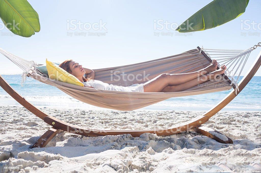 Brunette relaxing in the hammock stock photo