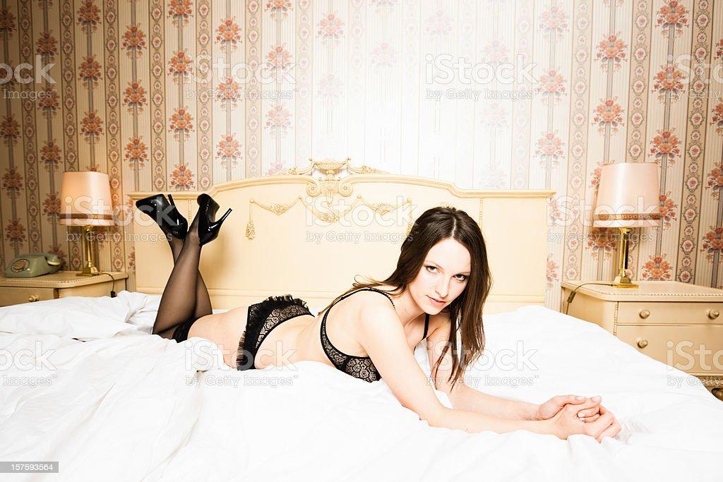 Brunette Seducing Girl in Black Lingerie royalty-free stock photo