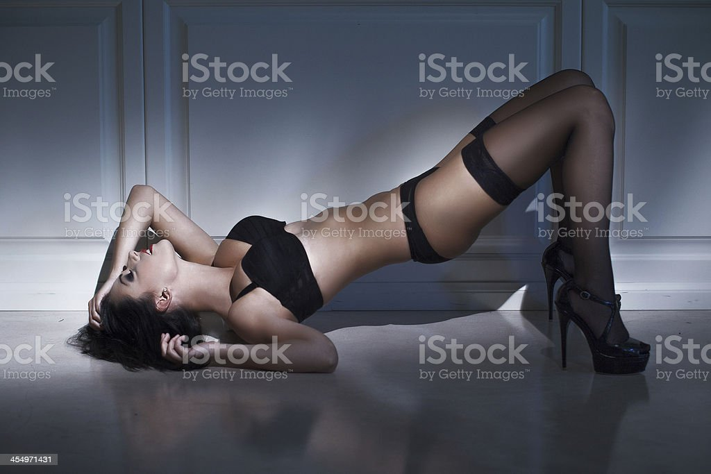 Brunette sexy woman laying on floor royalty-free stock photo