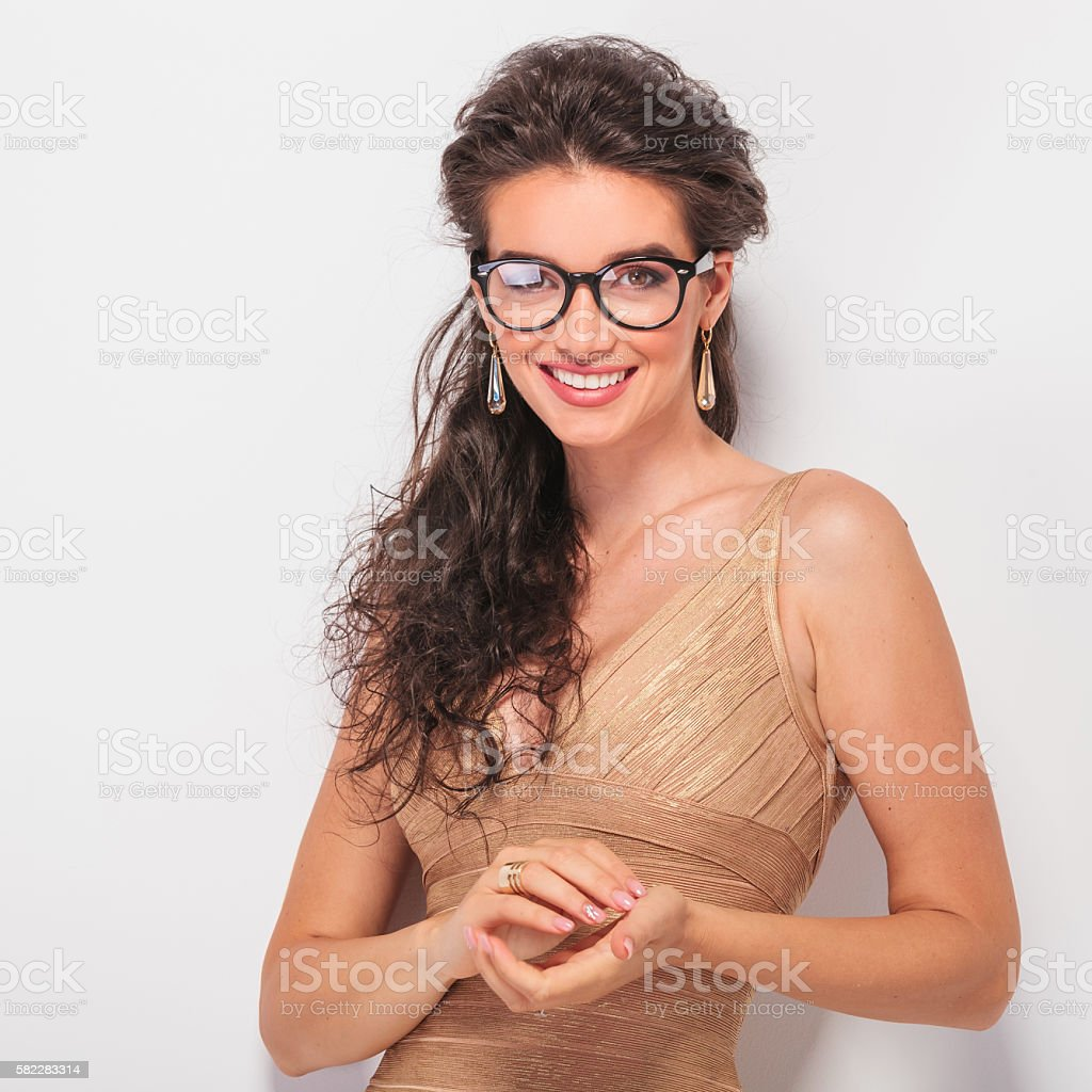 brunette smiling, posing and touchig hands stock photo