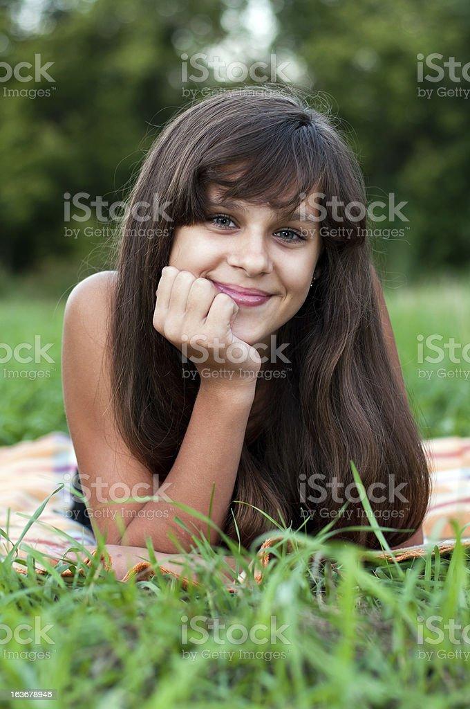 Brunette teen girl on nature royalty-free stock photo