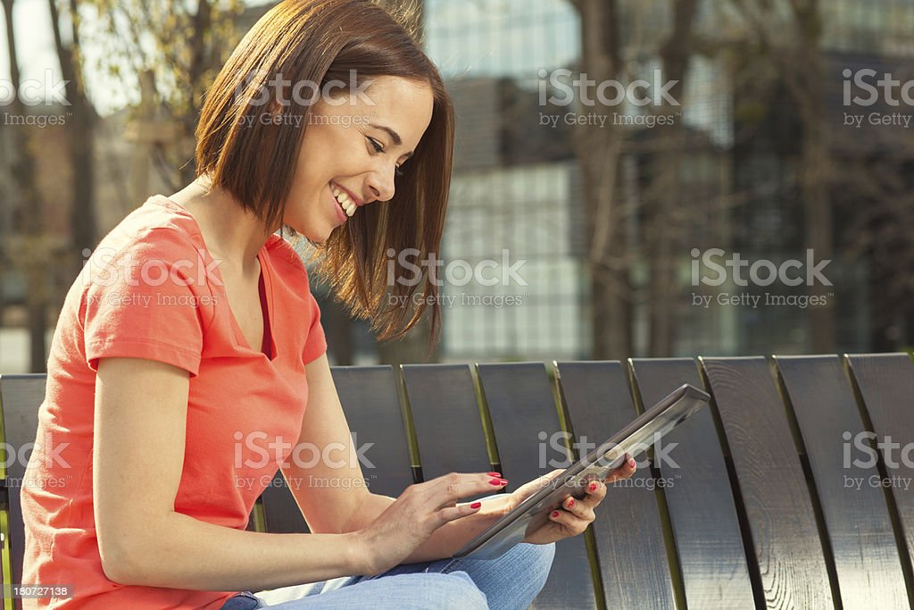 Brunette using tablet PC royalty-free stock photo