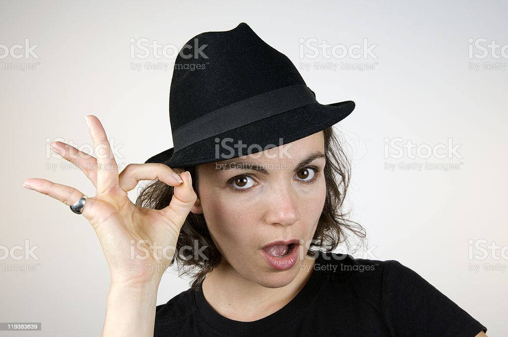 Brunette With Black Hat OK Sign royalty-free stock photo