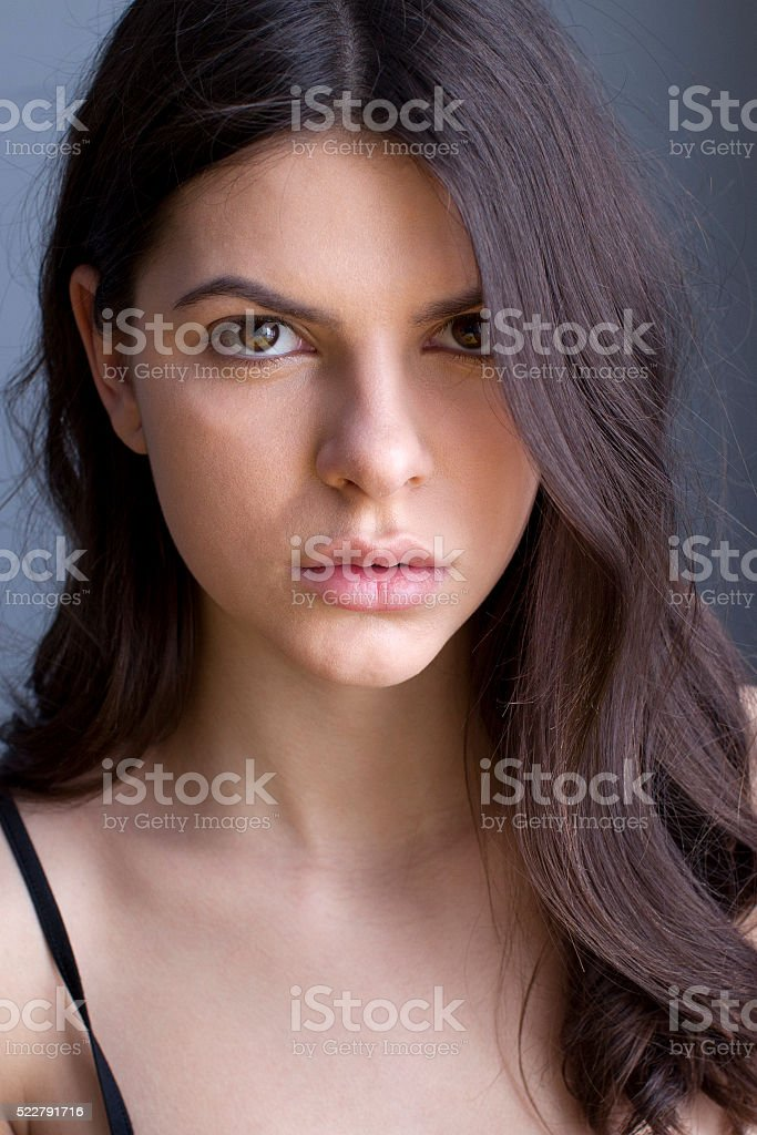 Brunette with curly hair stock photo