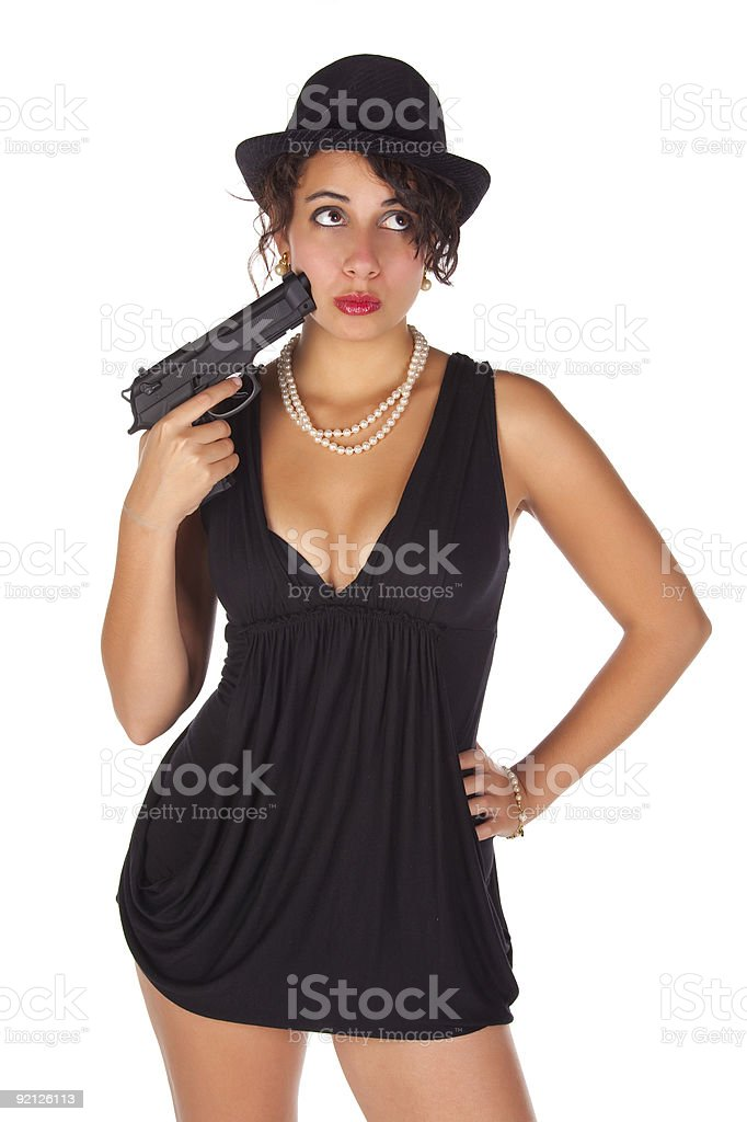 Brunette with gun and black hat royalty-free stock photo