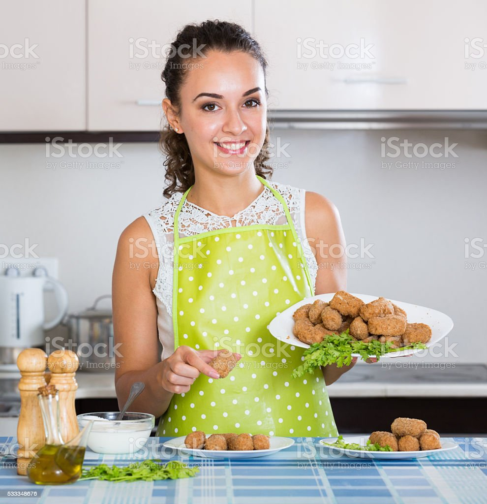 brunette with home-made croquettes stock photo