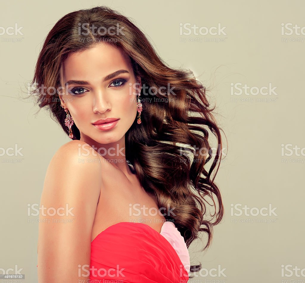 Brunette with long curled hair stock photo