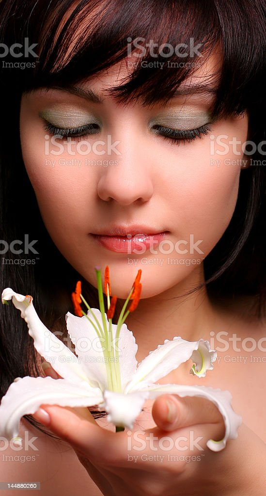 brunette with white lily flowers royalty-free stock photo