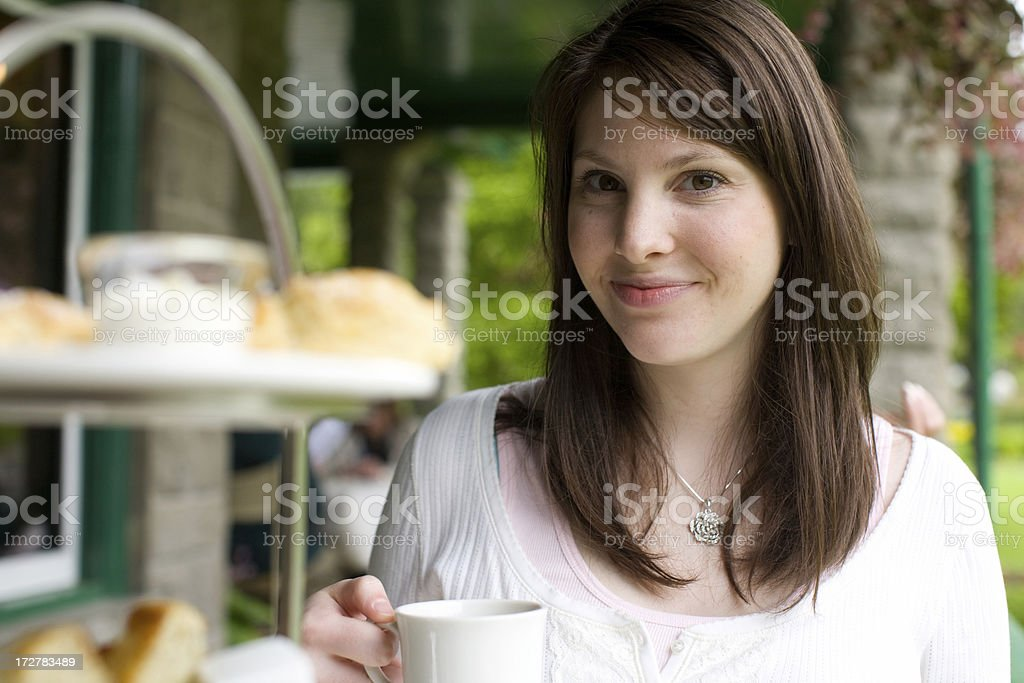 brunette woman at a tea royalty-free stock photo