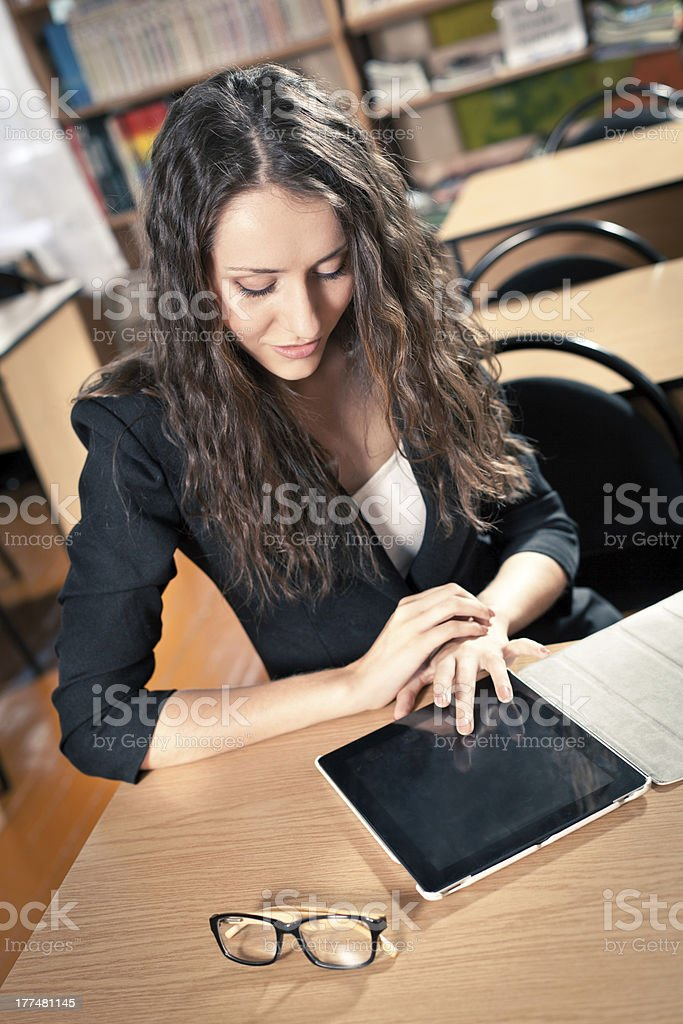 brunette woman at library royalty-free stock photo