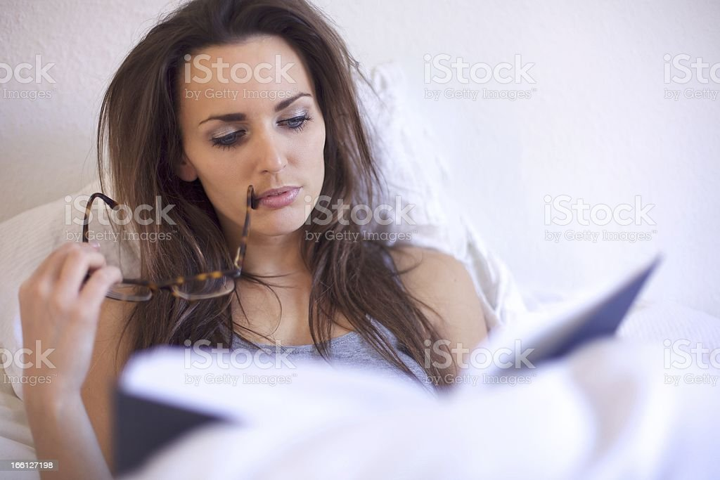 Brunette Woman Engrossed in Her Reading royalty-free stock photo