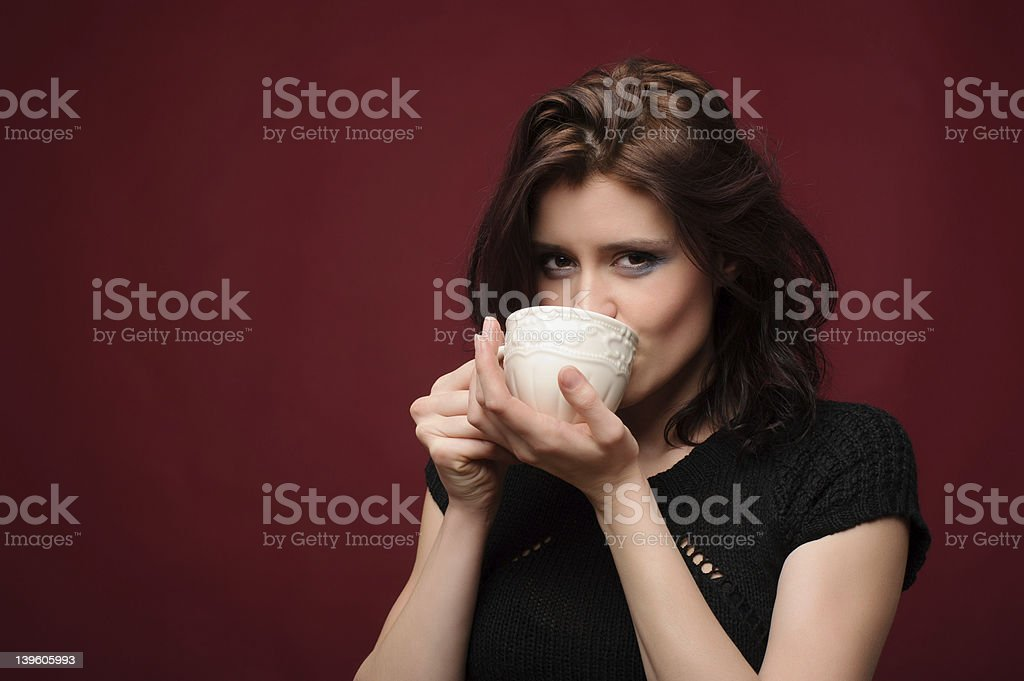 Brunette woman enjoying a hot beverage royalty-free stock photo