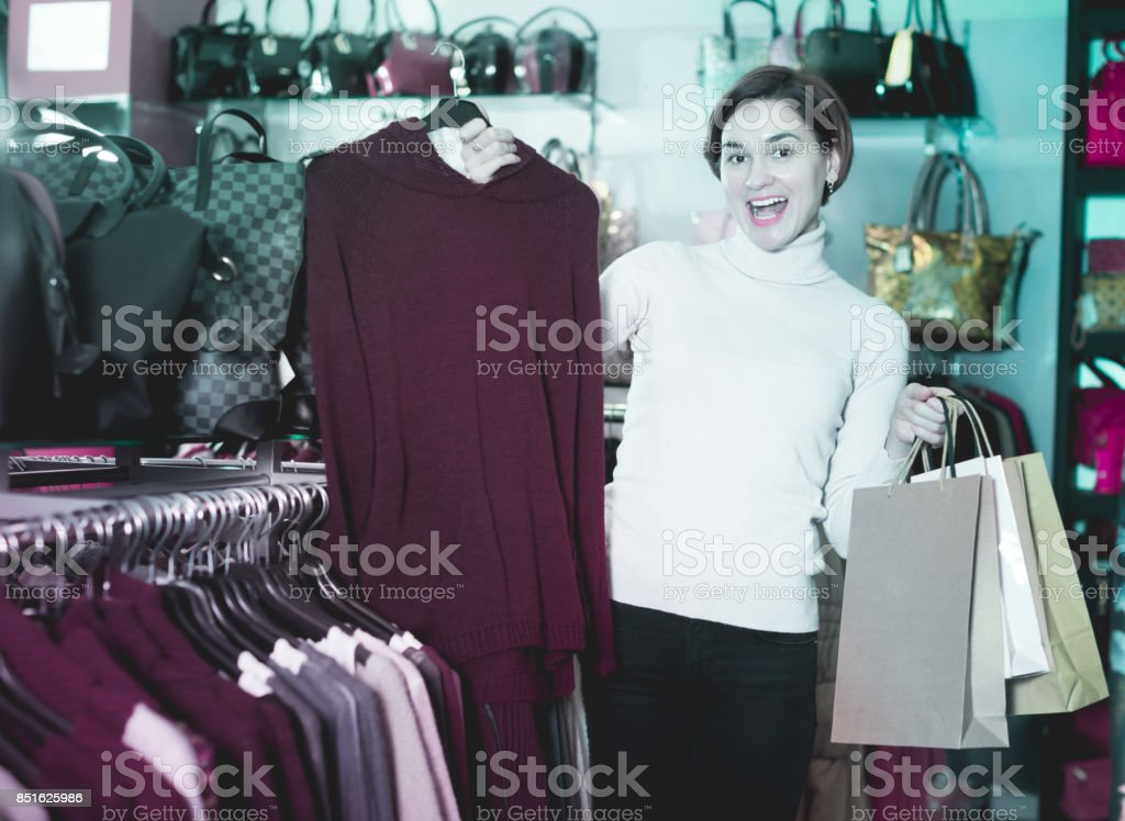 Brunette woman enjoying her purchases stock photo