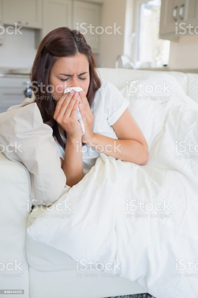 Brunette woman feeling sick stock photo