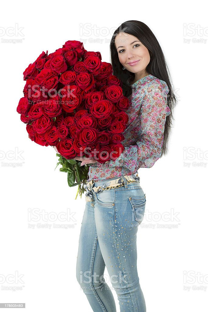Brunette woman holding a large bouquet of red roses royalty-free stock photo