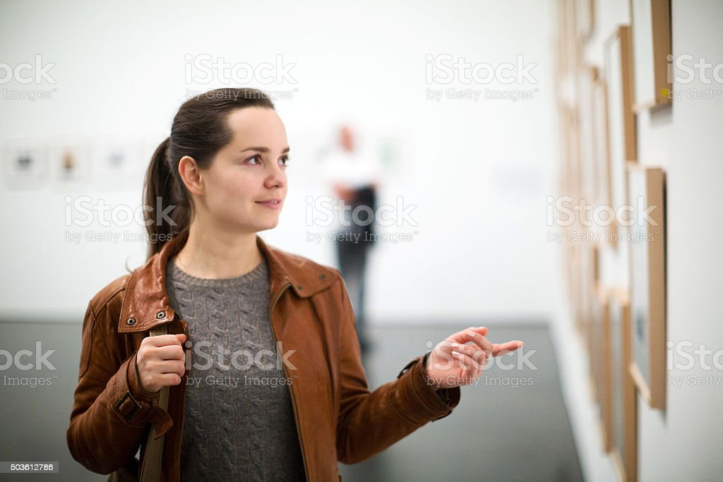 Brunette woman in art museum stock photo