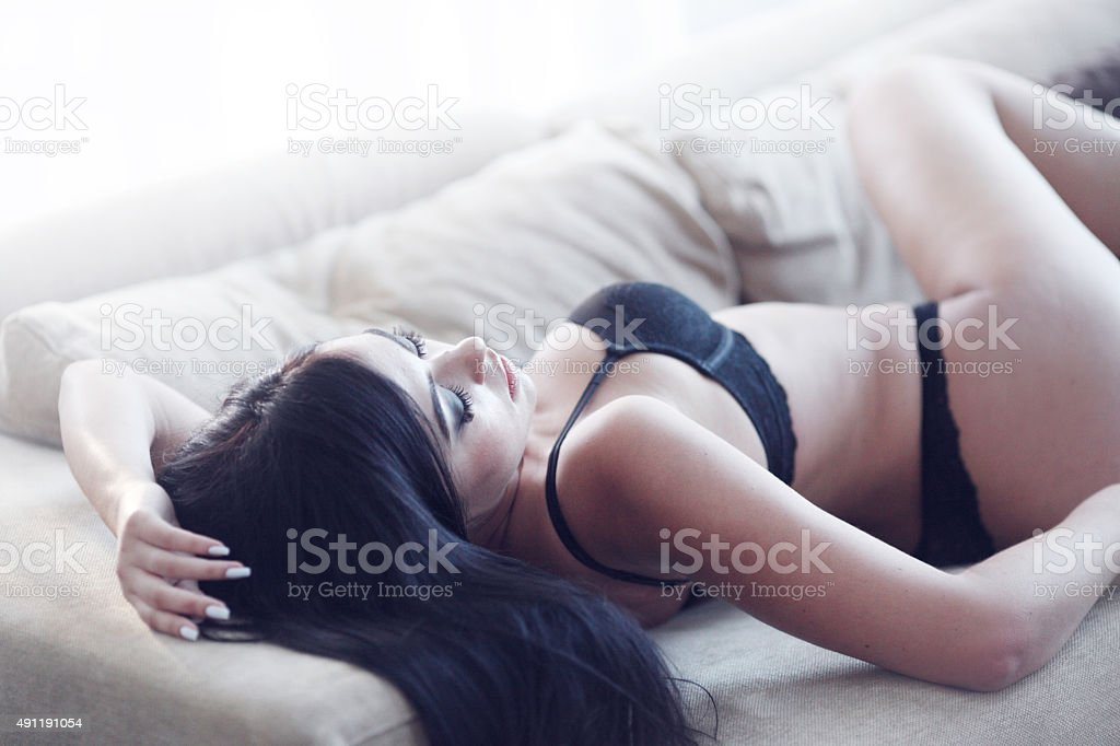 Brunette woman in sexy lingerie stock photo