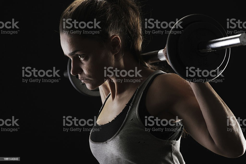Brunette woman lifting weights royalty-free stock photo