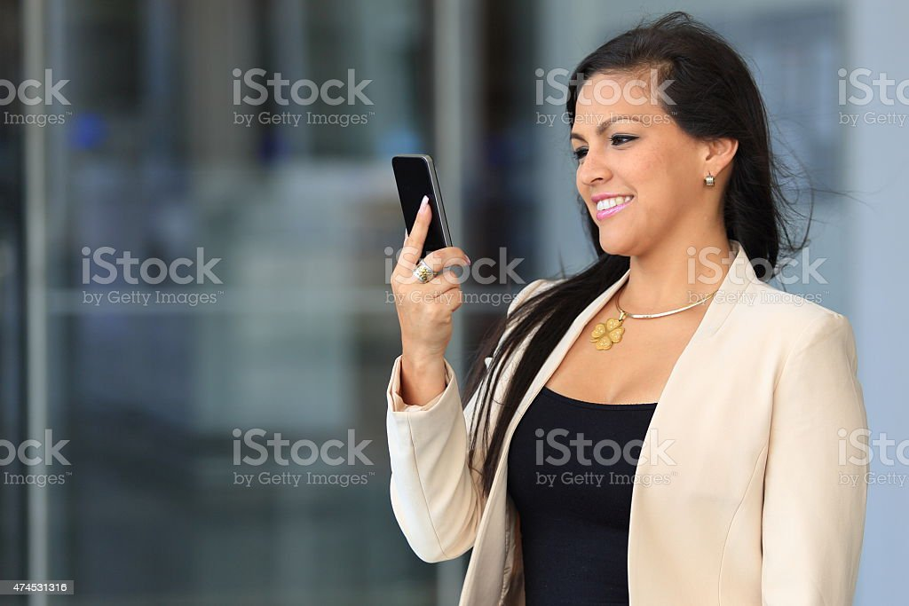 Brunette Woman Looking Whos is Calling stock photo