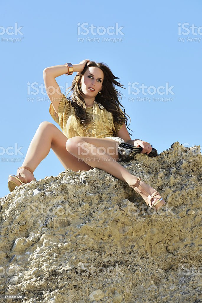 Brunette Woman on the Rock royalty-free stock photo