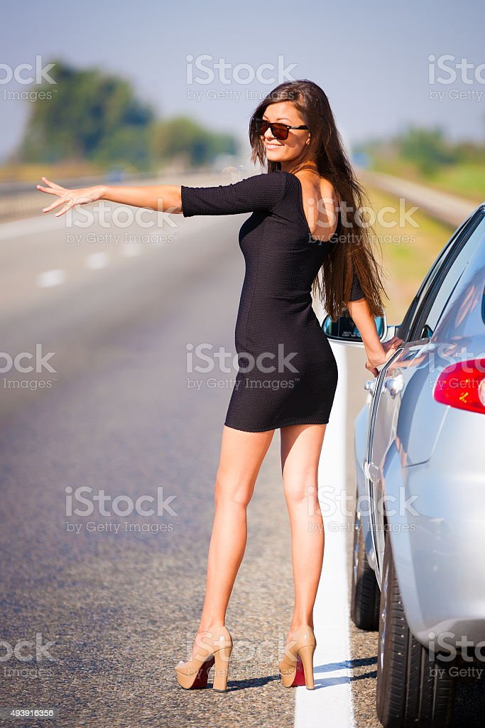 brunette woman road car stock photo