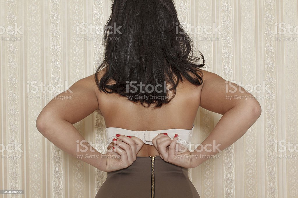 Brunette woman take off bra royalty-free stock photo