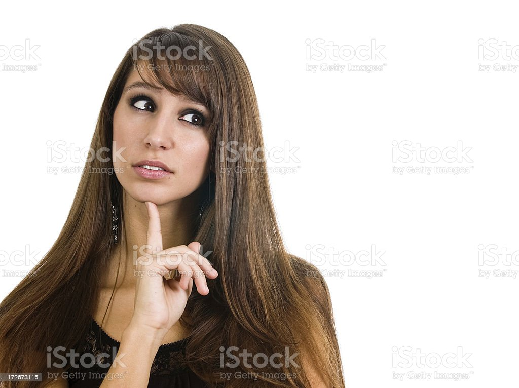 Brunette woman thinking with her index finger on her chin royalty-free stock photo