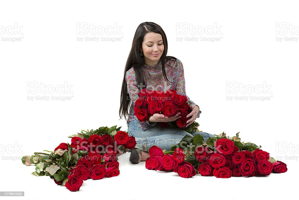 Brunette woman with a big bouquet of red roses royalty-free stock photo