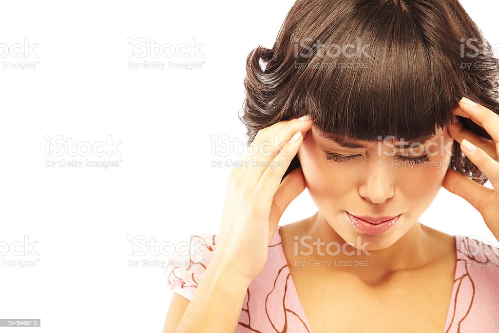 Brunette woman with a headache holding her temples royalty-free stock photo