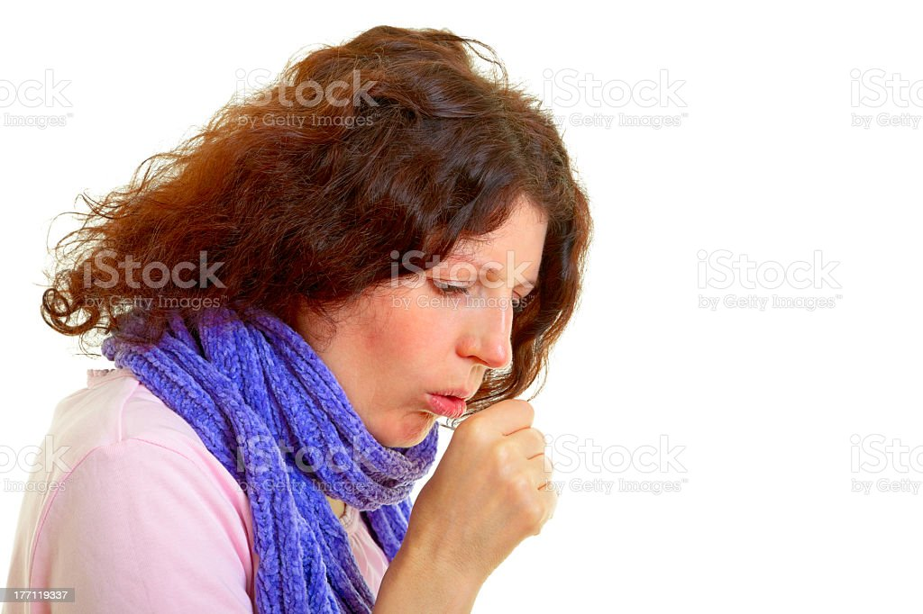 Brunette woman with blue scarf coughing on white background stock photo