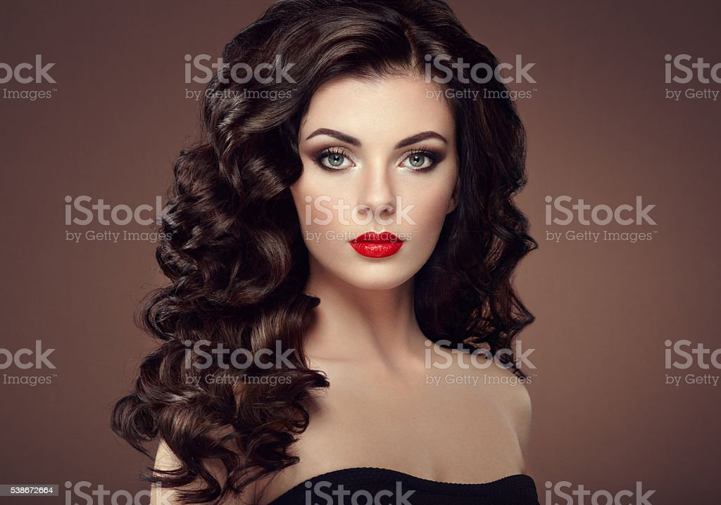 Brunette woman with curly hairstyle stock photo
