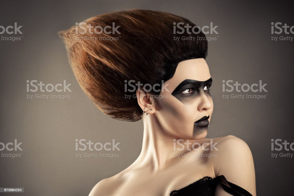 brunette woman with fashion hairstyle and creative dark make-up stock photo