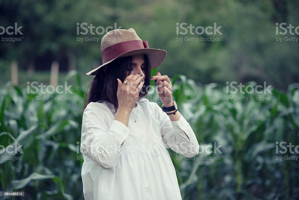 Brunette Woman with Hat in the Corn Field stock photo