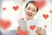 Brunette woman with love letter