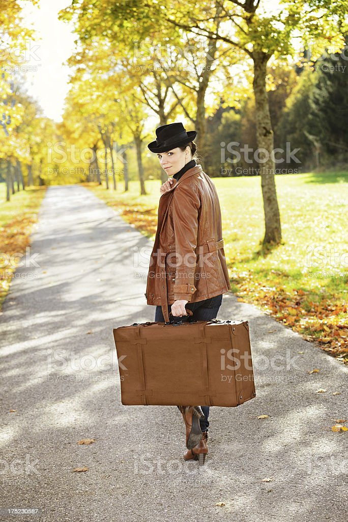 Brunette Woman with Suitcase royalty-free stock photo