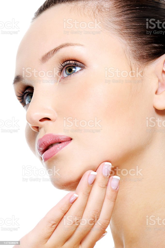 Brunette woman's face with clean skin and light make up stock photo