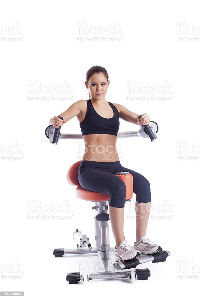 Brunette young woman on orange exerciser royalty-free stock photo