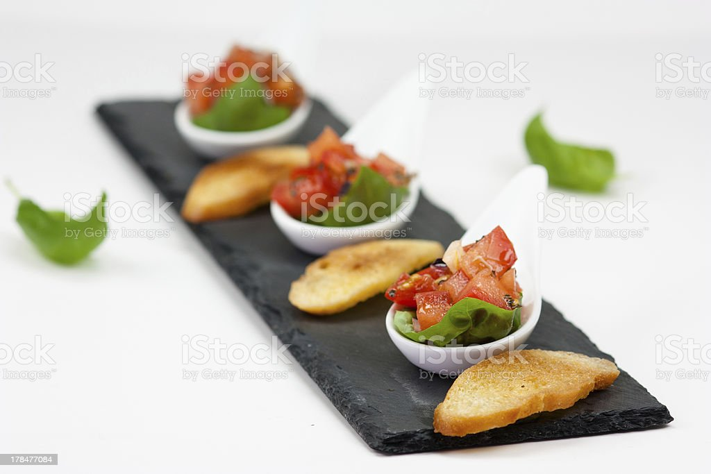 Bruschetta and tomato salad royalty-free stock photo