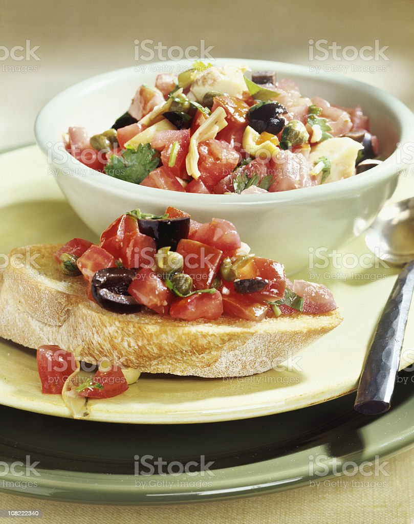 Bruschetta on Bread Slice with Plate stock photo