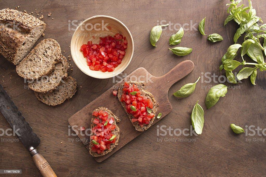 Bruschetta on wooden table royalty-free stock photo