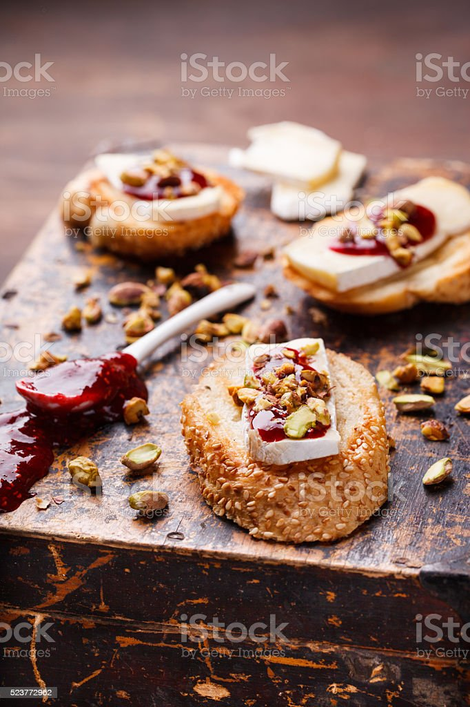 Bruschetta with brie cheese and raspberry jam stock photo