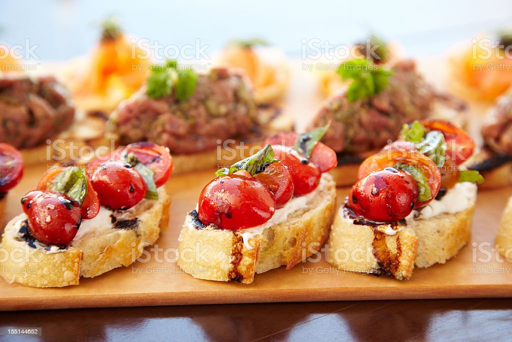 Bruschetta with cheese, tomatoes and foie gras pate stock photo