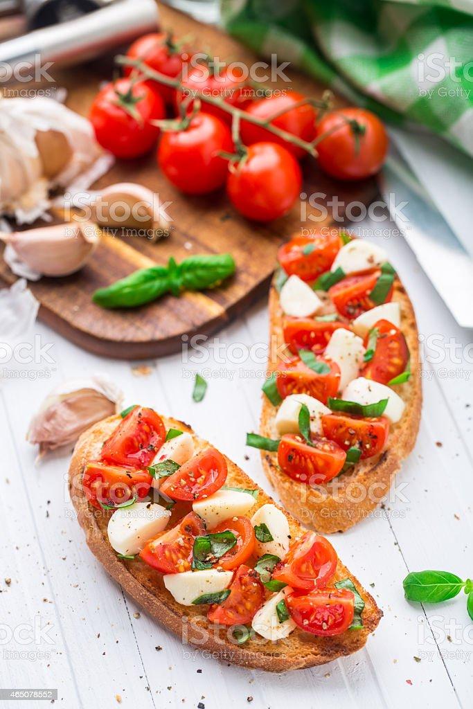 Bruschetta with cherry tomato and mozzarella stock photo